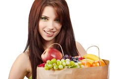 Woman with fruits and vegetables. Stock Photos