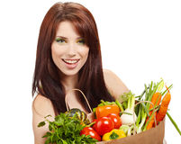 Woman with fruits and vegetables. royalty free stock photography