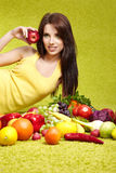 Woman with fruits and vegetables Royalty Free Stock Photos