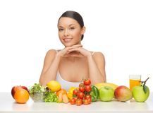 Woman with fruits and vegetables Royalty Free Stock Image