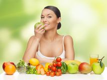 Woman with fruits and vegetables Royalty Free Stock Photo