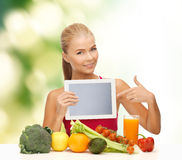 Woman with fruits, vegetables and tablet pc. Fitness, diet, technology, health and food concept - sporty woman with fruits and vegetables pointing at tablet pc Stock Photos