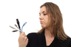 Woman frustrated with computer cables Stock Photos