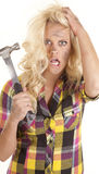 Woman frustrated with hammer in hand Stock Photo