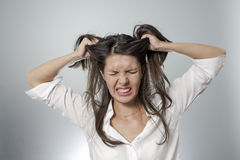 Woman is frustrated. Woman with headache and negative face expression Royalty Free Stock Image