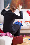 Woman is frustrated of mess at home. Active businesswoman and mother is frustrated of big mess at home stock photo