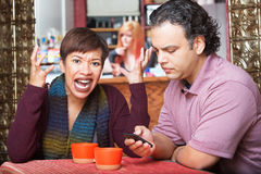 Woman Frustrated with Texting Royalty Free Stock Images