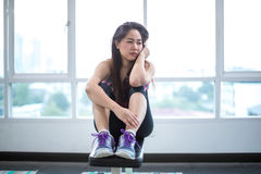 Woman frustrated and tired in sport club. Young asian woman frustrated and tired in sport club Stock Photo