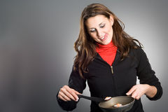 Woman Frying Eggs stock images