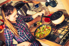 Woman frying frozen vegetables. Stir fry. Royalty Free Stock Photo