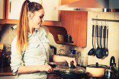 Woman frying frozen vegetables. Stir fry. Stock Images