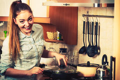 Woman frying frozen vegetables. Stir fry. Woman in kitchen cooking stir fry frozen vegetables. Girl frying making delicious risotto. Dinner food meal. Instagram stock photos