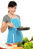 Woman with frying pan. Young woman with frying pan ready to cook something royalty free stock photography