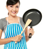 Woman with frying pan. Young woman with frying pan ready to cook something royalty free stock photo