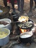 Woman frying snacks Stock Image