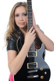 Woman in a full-length with a black guitar Royalty Free Stock Photography