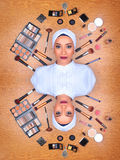 Woman in full makeup surrounded by makeup stock photos
