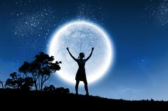 Woman and full moon Stock Photo