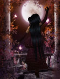 Woman with full moon Stock Photography
