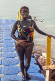 Woman full of mud in the Dead Sea Royalty Free Stock Photo