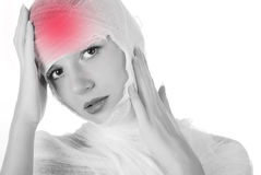 Woman fully in bandage. Young beautiful woman fully in bandage with headache Royalty Free Stock Photography
