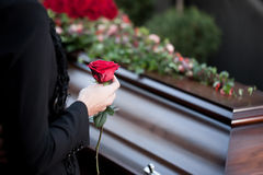 Woman at Funeral with coffin. Religion, death and dolor  - funeral and cemetery; funeral with coffin Royalty Free Stock Photography