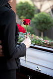 Woman at Funeral with coffin. Religion, death and dolor  - funeral and cemetery; funeral with coffin Stock Photography