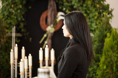 Woman at funeral mourning. Religion, death and dolor  - woman at urn funeral mourning the death of a loved person Royalty Free Stock Photo