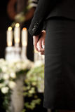 Woman at funeral mourning. Religion, death and dolor  - woman at urn funeral mourning the death of a loved person Stock Photos