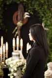 Woman at funeral mourning. Religion, death and dolor  - woman at urn funeral mourning the death of a loved person Royalty Free Stock Images