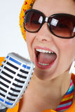 Woman funky singer with microphone Stock Photography