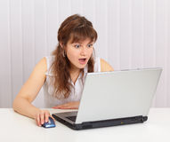 Woman funny emotionally looking in laptop screen Royalty Free Stock Photo