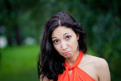 Woman with a funny expression. Cute woman making a funny angry face Royalty Free Stock Image
