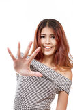 Woman with funny face showing stop, reject, refuse hand sign Royalty Free Stock Photo