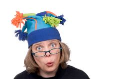 Woman in funny hat Stock Images
