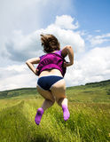 Woman in a funny jump Stock Images