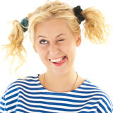 Woman with a funny look on her face smiles Stock Photography