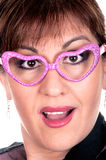 Woman in funny pink glasses Stock Photography