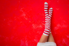 Woman in funny socks. Woman in funny Christmas socks Royalty Free Stock Photo