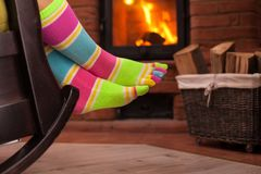 Woman with funny socks relaxing in the evening by the fireplace royalty free stock photo