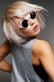 Woman in funny sunglasses turning Stock Image