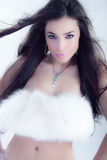 Woman in fur. Young lady with fur over torso Royalty Free Stock Photography
