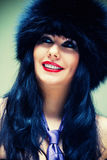 Woman in fur cap Stock Image
