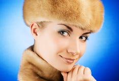 Woman in fur cap Stock Image