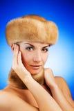 Woman in fur cap. Beautiful young woman in fur cap Royalty Free Stock Images