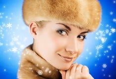 Woman in fur cap Stock Photo