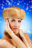 Woman in fur cap Stock Photos