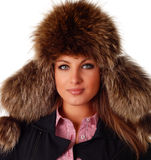 Woman in fur cap Stock Images