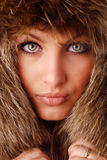 Woman in fur cap Stock Photo