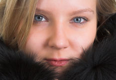 Woman with fur coat. Portrait of young blond woman with black fur coat Royalty Free Stock Photography
